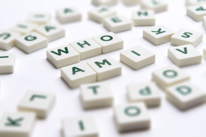 "Text ""Who am I"" made of single letter block with tilt-shift and shallow depth of field. Alphabet Contemplation Crisis Dilemma Existence Identity Crisis Letters Meaning Mental Personality  Psychology Purpose Of Life Questioning Roles Selective Focus Wonder Word"