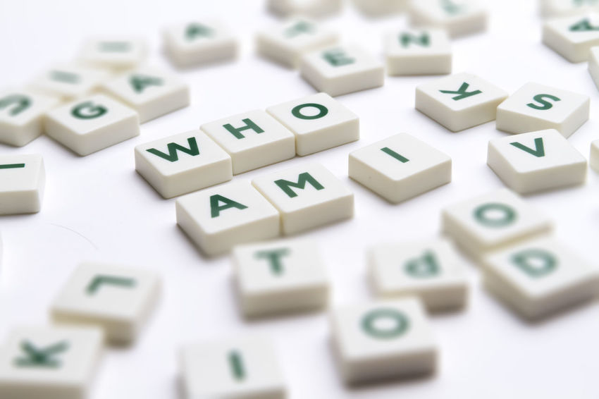 """Text """"Who am I"""" made of single letter block with tilt-shift and shallow depth of field. Alphabet Contemplation Crisis Dilemma Existence Identity Crisis Letters Meaning Mental Personality  Psychology Purpose Of Life Questioning Roles Selective Focus Wonder Word"""
