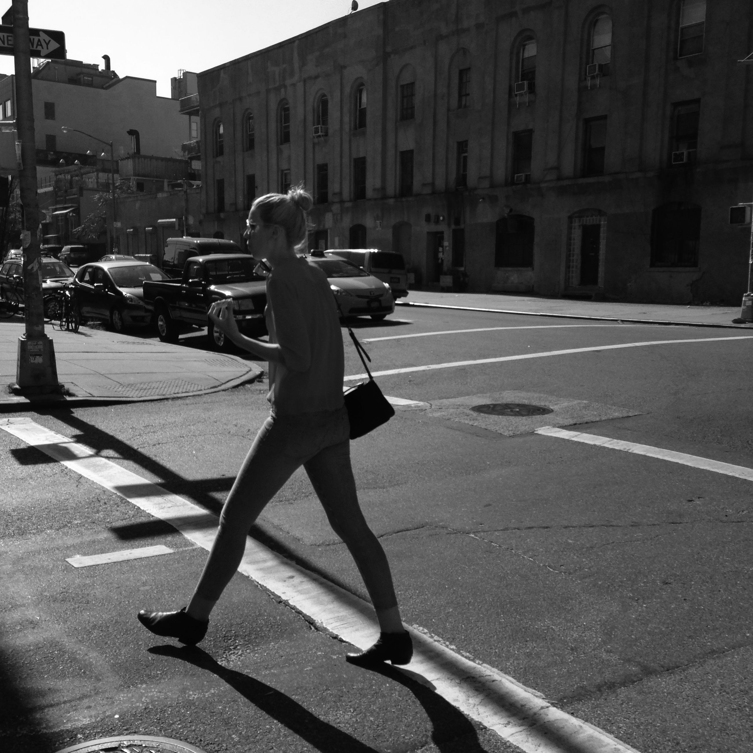 building exterior, street, architecture, built structure, city, transportation, city life, lifestyles, walking, car, men, road, city street, mode of transport, sunlight, person, land vehicle, leisure activity