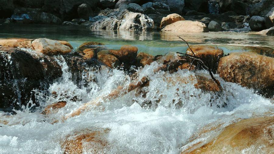 View of sea waves splashing on rocks