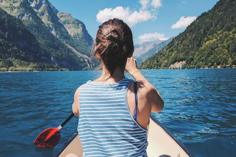 Canoe Water Leisure Activity Beauty In Nature One Person Nature Mountain Lifestyles Rear View Outdoors Lake The Great Outdoors - 2018 EyeEm Awards