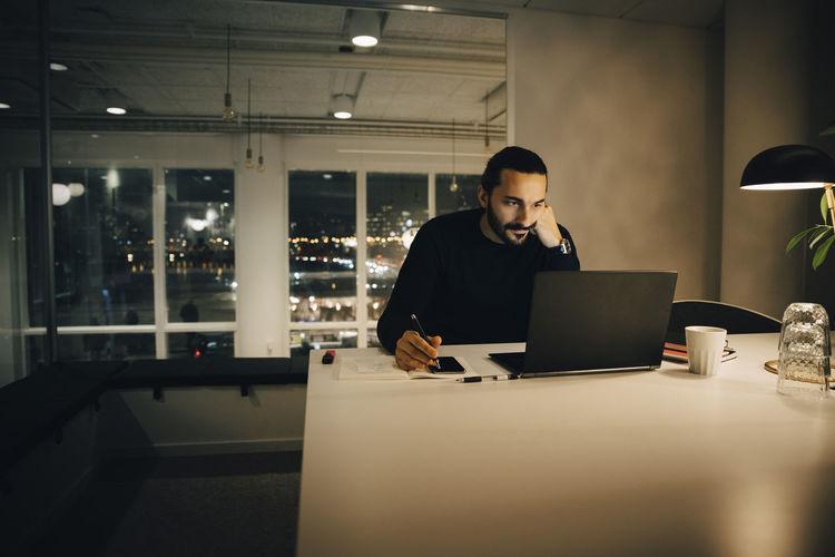 Full length of senior man using laptop