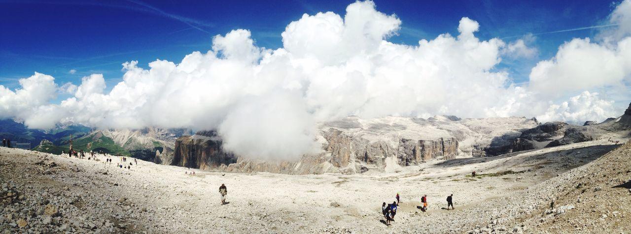 People against mountains at pordoi pass
