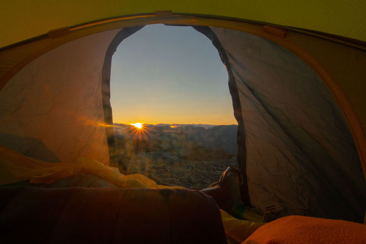amazing sunrise after a cold night in telemark, norway Holiday View Adventure Arid Climate Beauty In Nature Day Environment Land Landscape Mode Of Transportation Mountain Nature No People Outdoors Rock Scenics Scenics - Nature Sky Sun Sunlight Sunset Tent Transportation Travel Window