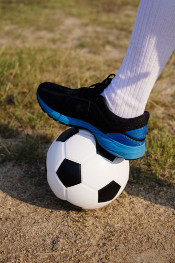Low section of person playing soccer