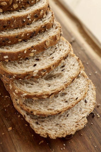 Sliced multigrain bread on cutting board. Diagonal view. Vertical frame. Breakfast Diet Natural Wheat Bake Bakery Bread Brown Bread Close-up Crust Directly Above Food Food And Drink Grain Healthy Eating Loaf Loaf Of Bread Multigrainbread No People Sliced Sliced Bread Studio Photography Wholemeal Bread