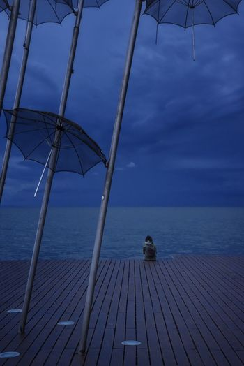 She Moody Sky Moody Evening Woman Rear View Umbrella Sculpture EyeEm Best Shots Eye4photography  EyeEm Gallery Dramatic Sky Cold Temperature Winter Getting Inspired Horizon Over Water Peaceful Calm Tranquil Scene Lonely Loneliness Beauty In Nature women around the world Seascape Water Sea City Blue Sky Landscape Weather