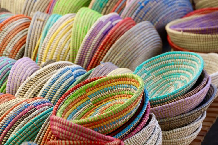 Close-up of multi colored baskets for  sale at market stall