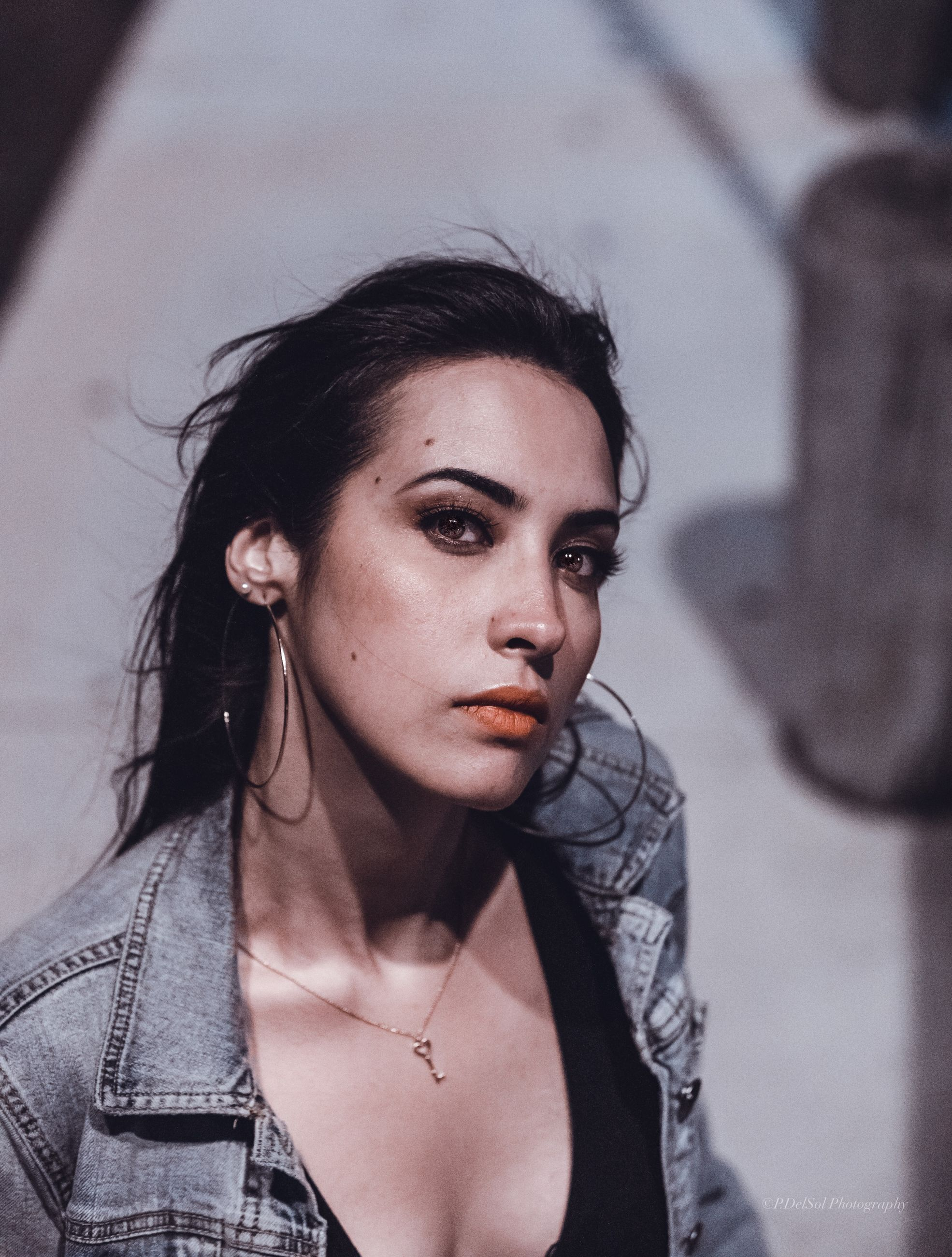 young adult, one person, portrait, young women, lifestyles, front view, real people, leisure activity, beauty, headshot, focus on foreground, looking at camera, casual clothing, indoors, hair, beautiful woman, adult, women, hairstyle, contemplation, leather