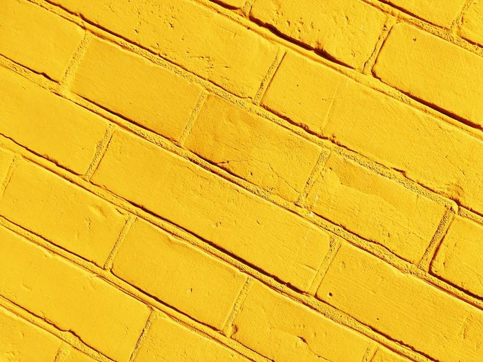 Yellow wall Wall Brick Wall Brick Colors Yellow Close-up Abstract Colour Of Life Color Palette Paint The Town Yellow