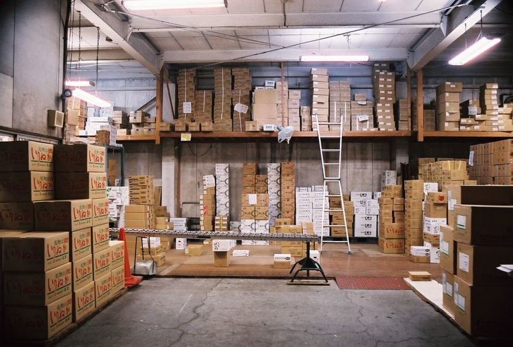 Cardboard boxes arranged at warehouse