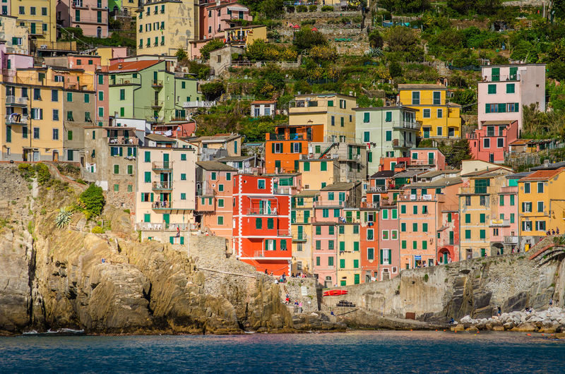 Colorful houses of Riomaggiore, Cinque Terre Architecture Building Exterior Sea Nature Travel Destinations Outdoors Liguria Cinque Terre Italy Tourism Travel Architecture Houses Vivid Colours  Colorful Sunny Day Town Rocks Waterfront Rock - Object Built Structure Seaside Beautiful Beauty In Nature Residential District