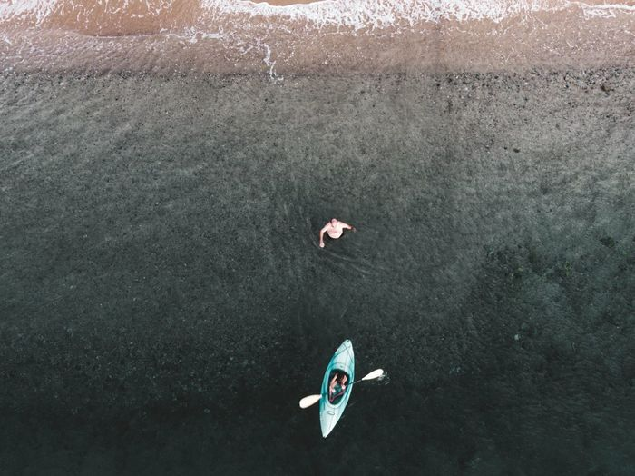 Aerial view of woman kayaking in sea