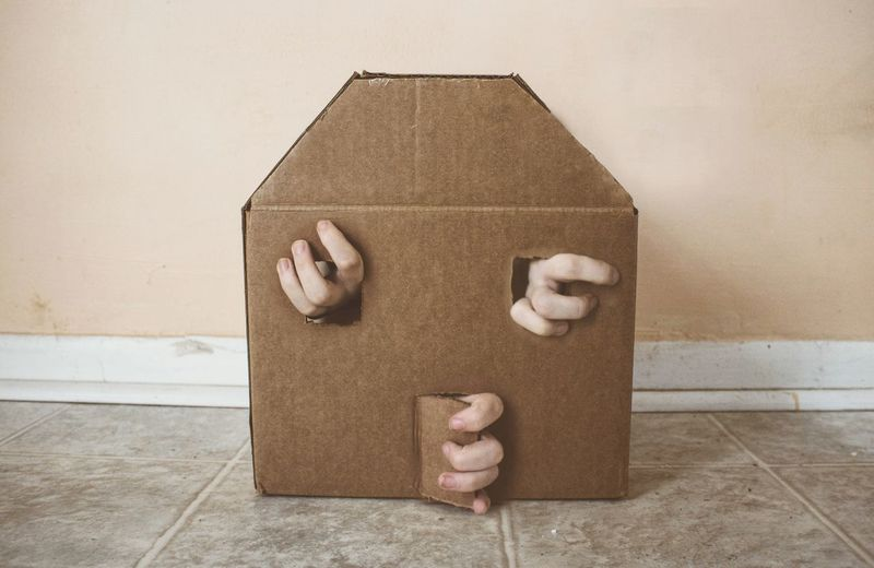 Midsection of person holding paper in box