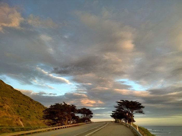 Taking Photos Open Road On The Road Drive Along The Coast Outdoor Photography Beach Photography Landscape Mypointofview California Coast Driving Open Highways Cloudporn Clouds Hugging A Tree