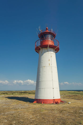 Lighthouse List-West Architecture Protection Nature Sky Security Blue Building Lighthouse Outdoors Tower Deutschland Direction Sylt Sylt, Germany Guidance Safety No People Building Exterior Built Structure North Sea Coast Ellenbogen, Sylt Lighthouse List-West Sylter Leuchttürme Day Leuchttürme Leuchtturm
