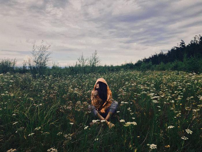 Woman On Field Against Sky