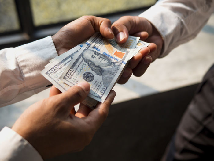 Businessmen give money to his partner, business concept. Human Hand Hand Human Body Part Finance Holding Business Currency Wealth Paper Currency Two People Men People Paying Close-up Giving Body Part Adult Real People Savings Occupation Consumerism