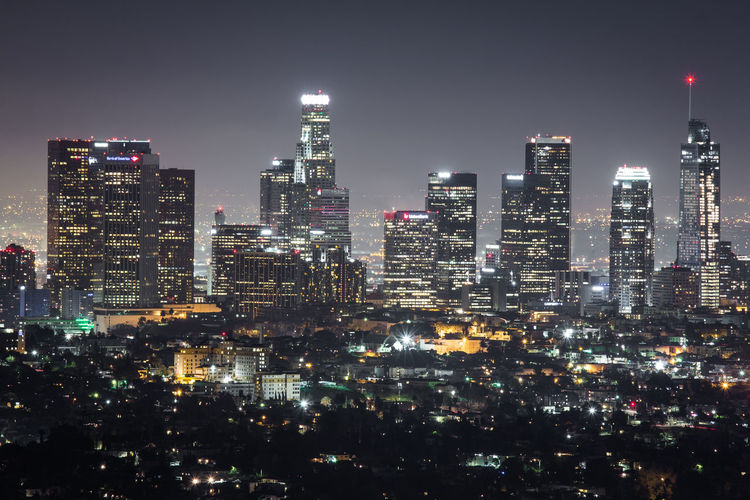 Aerial View Of City Lit Up At Night