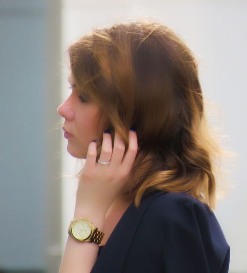 Side View Of Young Woman In City