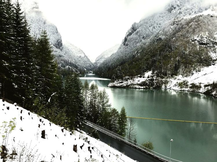 Snow Beauty In Nature Mountain Frozen Lake Springtime Swiss Alps No People Weather Water Sky The Secret Spaces
