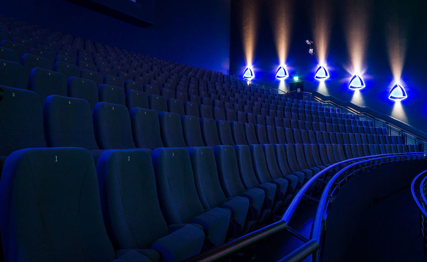Empty Blue Seats In Movie Theater