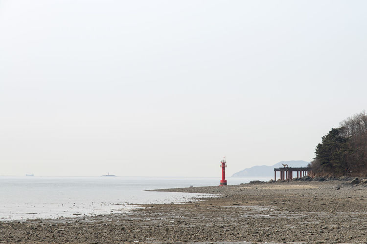 seaside view at Daebudo Island in Gyeonggido, South Korea Afternoon Daebudo Daebudo Island Architecture Beach Building Exterior Built Structure Clear Sky Copy Space Day Guidance Horizon Over Water Land Lighthouse Nature No People Outdoor Outdoors Protection Safety Scenics - Nature Sea Seascape Seaside Security Sky Tower Water