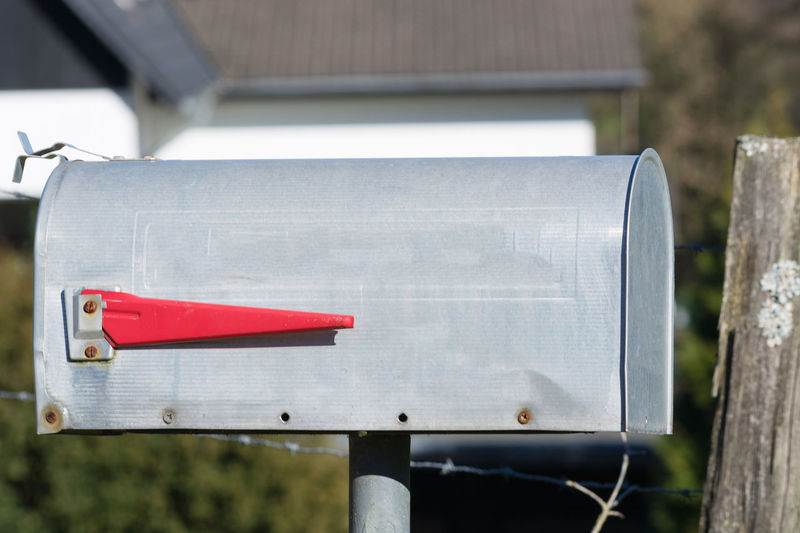 American mailbox with red flag Mailbox Post Postbox Letter Box Banner Red Silver  Metal American USA Arriving Row Close House City Exterior Freight Stamp Email Delivery Service Urban York Iron NYC Outdoors Residence Address Message Home Postage Mailman Newspaper America Shipping  Above Us Office BIG Mail New Parcel Closeup Send Envelope Container Day Focus On Foreground No People Communication Close-up Public Mailbox Wood - Material Nature Barrier Boundary Built Structure Paper Sunlight Plant Blank