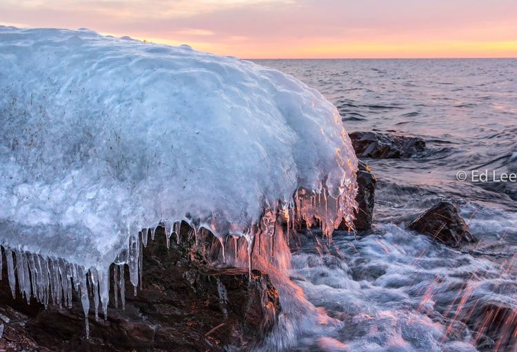 Panoramic view of frozen sea against sky during sunset