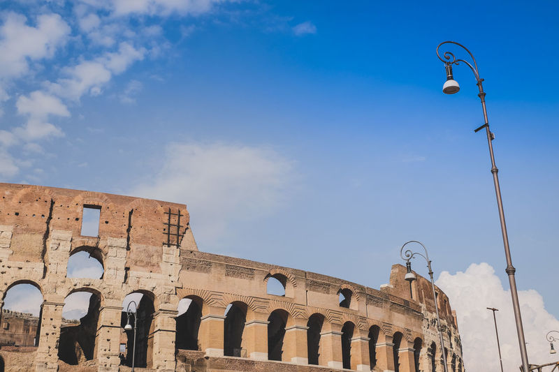 Arch Architectural Column Architecture Blue Built Structure City Cloud Cloud - Sky Colosseum Day Exterior High Section Historic History Italy Low Angle View No People Outdoors Rome Sky The Past Tourism Travel Destinations Neighborhood Map Your Ticket To Europe Moving Around Rome