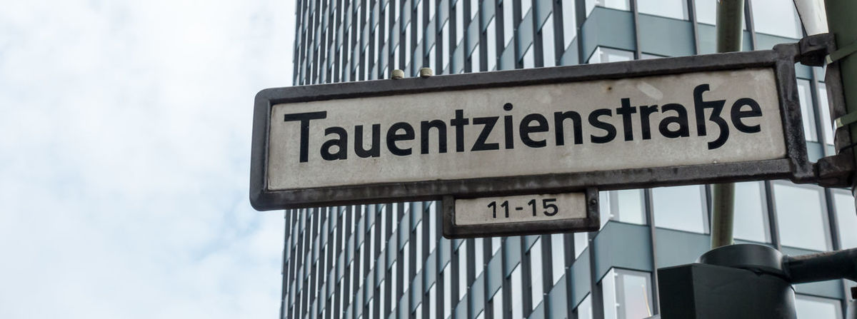 Architecture Building Exterior Built Structure Close-up Communication Day Guidance Low Angle View No People Outdoors Sky Straßenschild Street Name Sign Street Sign Tauentzienstrasse Text