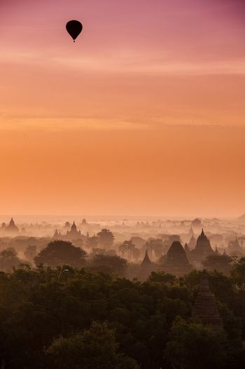 Sunrise - Hot air ballon flying alone - Bagan, Myanmar 🇲🇲 Silence Peace Fog Mist Historic Site Pagoda Hot Air Balloon Sunrise Sky Scenics - Nature Beauty In Nature Tranquil Scene Tranquility Environment No People Landscape Nature Non-urban Scene Orange Color Travel Destinations Idyllic Sun Outdoors