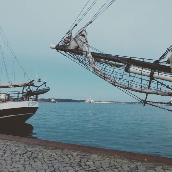 Nautical Vessel Transportation Mode Of Transport Sea Water Day Outdoors Connection No People Moored Harbor Mast Sky Ship Built Structure Nature Architecture
