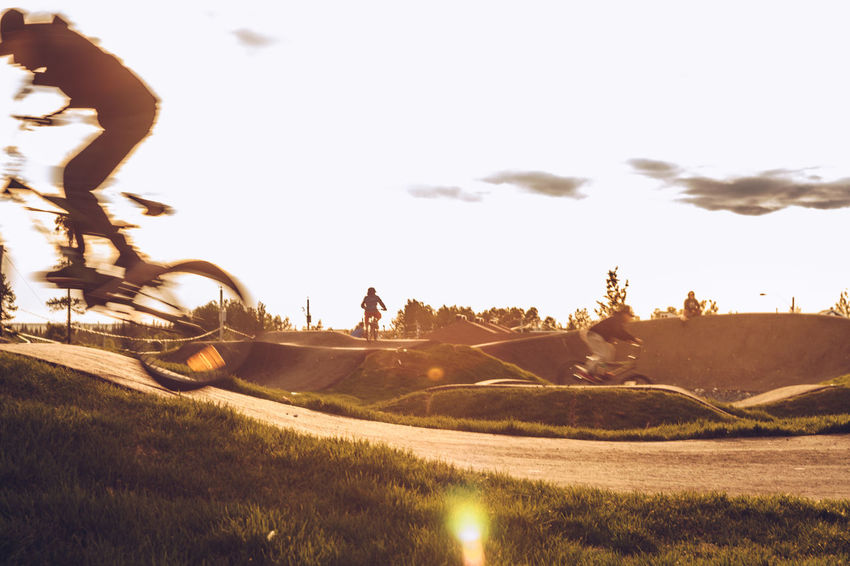 Extreme Sports - Sunset Cycle Track Excercising Beauty In Nature Bicycle Bicycle Track Cycle Track Cycling Day Extreme Sports Field Full Length Grass Landscape Leisure Activity Lifestyles Mammal Men Nature Outdoors People Real People Sky Sports Sunlight Sunset Track Two People Urban
