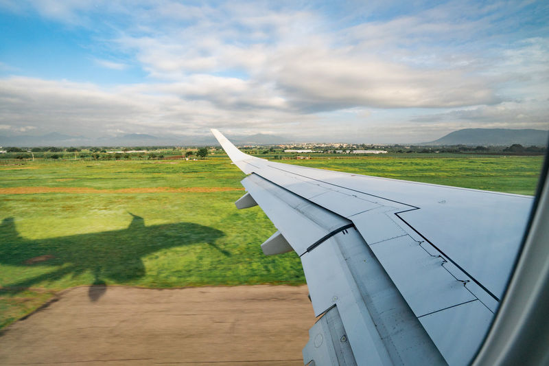 Off the Ground Flying High Aircraft Wing Airplane Cloud - Sky Environment Flying Landscape Mode Of Transportation Sky Tourism Travel