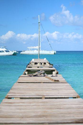 Ship on sea against blue sky