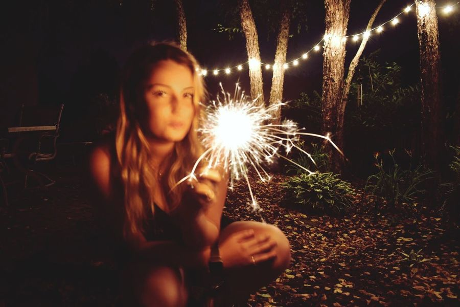 Sommergefühle Sparkler Night Sparks Firework - Man Made Object Illuminated Celebration Firework Display Motion Burning Long Exposure Holding One Person Front View Firework Girls Lifestyles Portrait Real People Outdoors Blurred Motion Sparkler