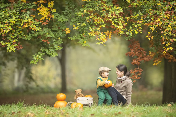 Mother and son on field during autumn