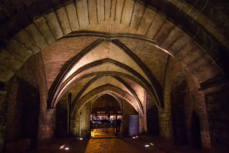 Arch Architecture Indoors  Built Structure The Way Forward Direction Building Ceiling Illuminated No People Empty Arcade Diminishing Perspective Corridor Old Wall Lighting Equipment Transportation Day History Architectural Column Arched Long