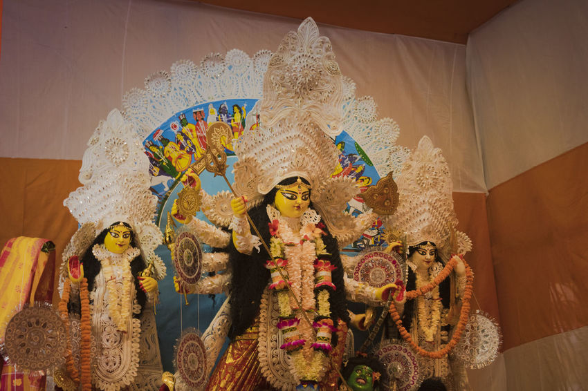 This is an idol of The Hindu Goddess Durga. It is hugely celebrated among Hindus. I captured it at Ram Krishna Ashrama , Rishra on the day of Nabami. Durga Durga Puja 2017 Festive Mood Paint The Town Yellow Architecture Art And Craft Close-up Day Human Representation Indoors  Low Angle View Multi Colored No People Place Of Worship Puja Religion Sculpture Spirituality Statue