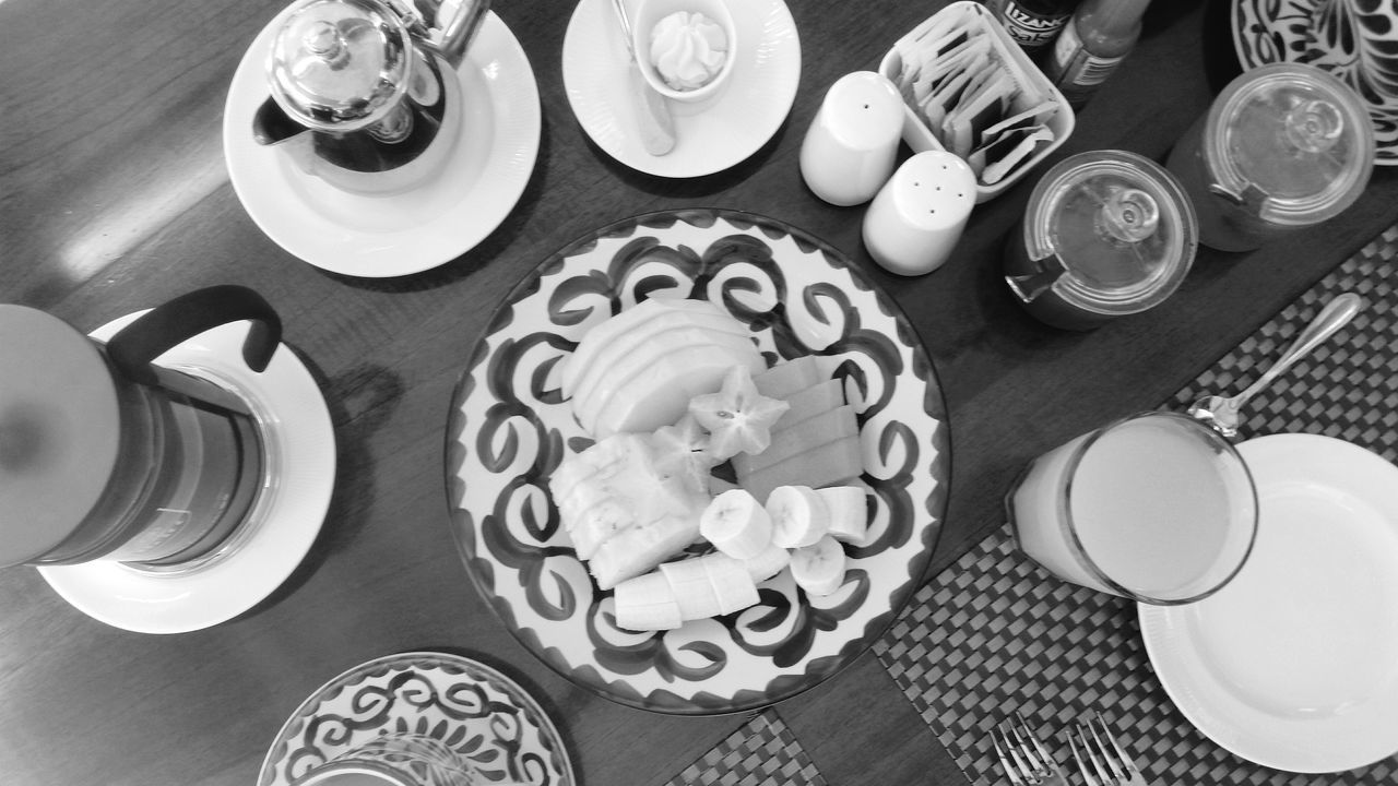table, food and drink, high angle view, plate, sweet food, indoors, indulgence, dessert, directly above, drinking glass, unhealthy eating, no people, refreshment, temptation, drink, cake, food, bowl, freshness, communication, cupcake, ready-to-eat, day, close-up