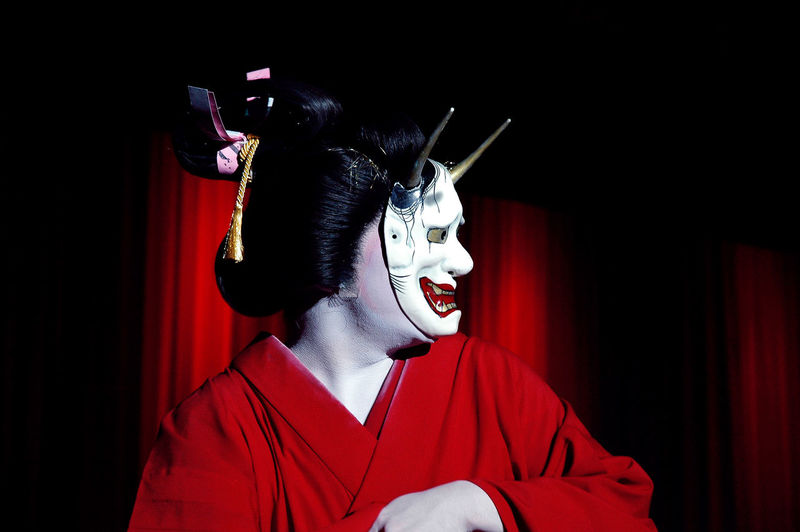 Close-up of japanese woman wearing traditional clothing and mask