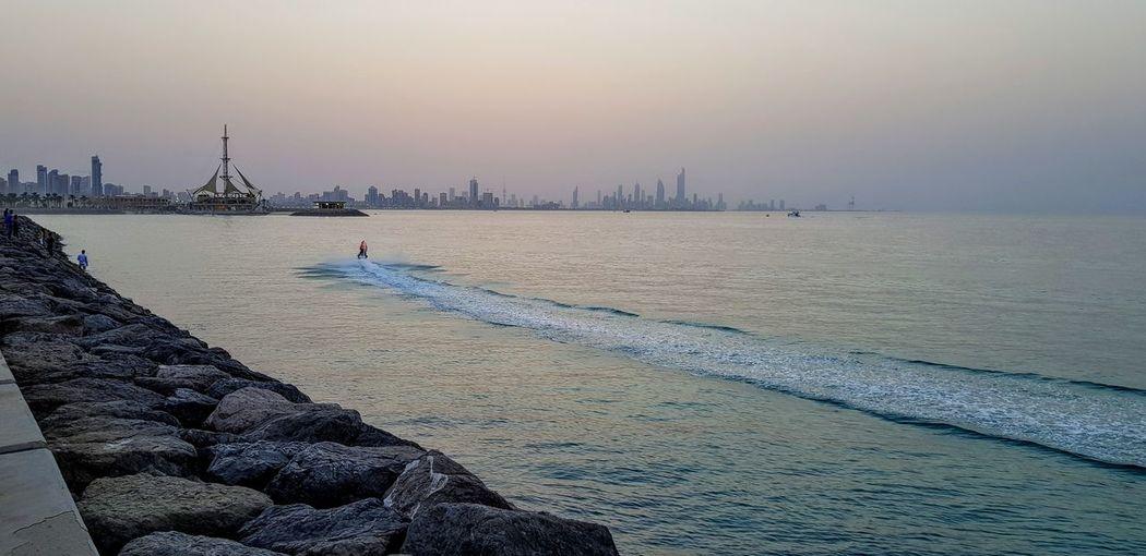 Sunset, Salmiya, Kuwait Water Nautical Vessel Sea Sunset Beach Beauty Low Tide Full Length Standing Multi Colored EyeEmNewHere #urbanana: The Urban Playground Urban Fashion Jungle