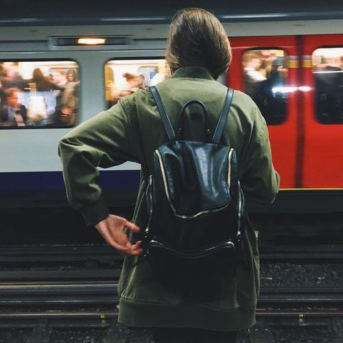 Woman Waiting On Railway Station Platform