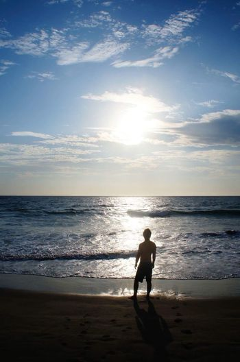 Outdoors Sea Beach One Person Full Length Horizon Over Water Sunlight Rear View Sky Water Sunset Lifestyles Real People Day Nature Vichayito EyeEmNewHere Live For The Story
