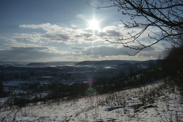 Scenic view of snowcapped landscape against sky during winter