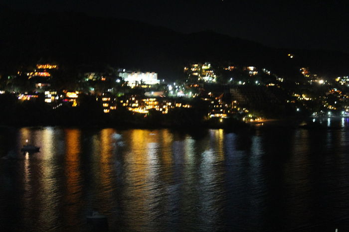 """Spirited Away"" Night Reflection Sea Lights Zihuatanejo, Gro. Traveling Home for the Holidays"