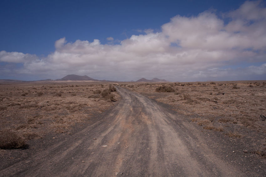 Lanzarote Arid Climate Beauty In Nature Cloud - Sky Day Desert Dirt Empty Road Landscape Nature No People Outdoors Road Scenics Sky The Way Forward Tranquil Scene Tranquility Transportation