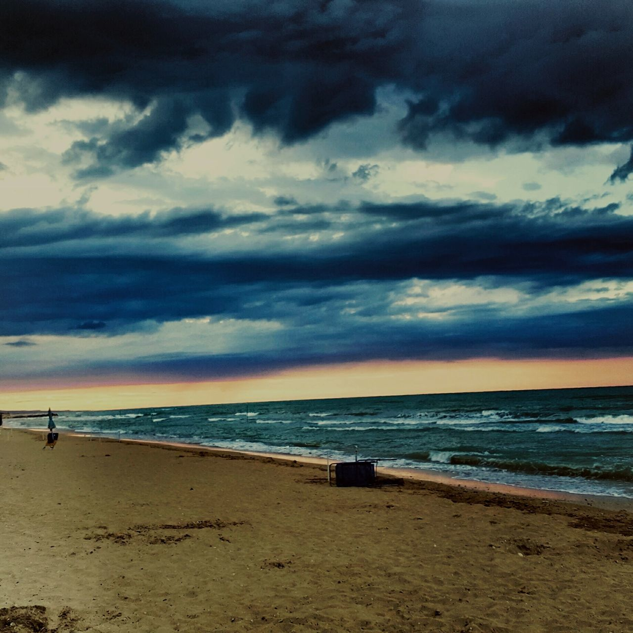 sea, beach, horizon over water, sand, water, cloud - sky, sky, shore, scenics, nature, beauty in nature, tranquil scene, tranquility, outdoors, wave, sunset, vacations, day, no people