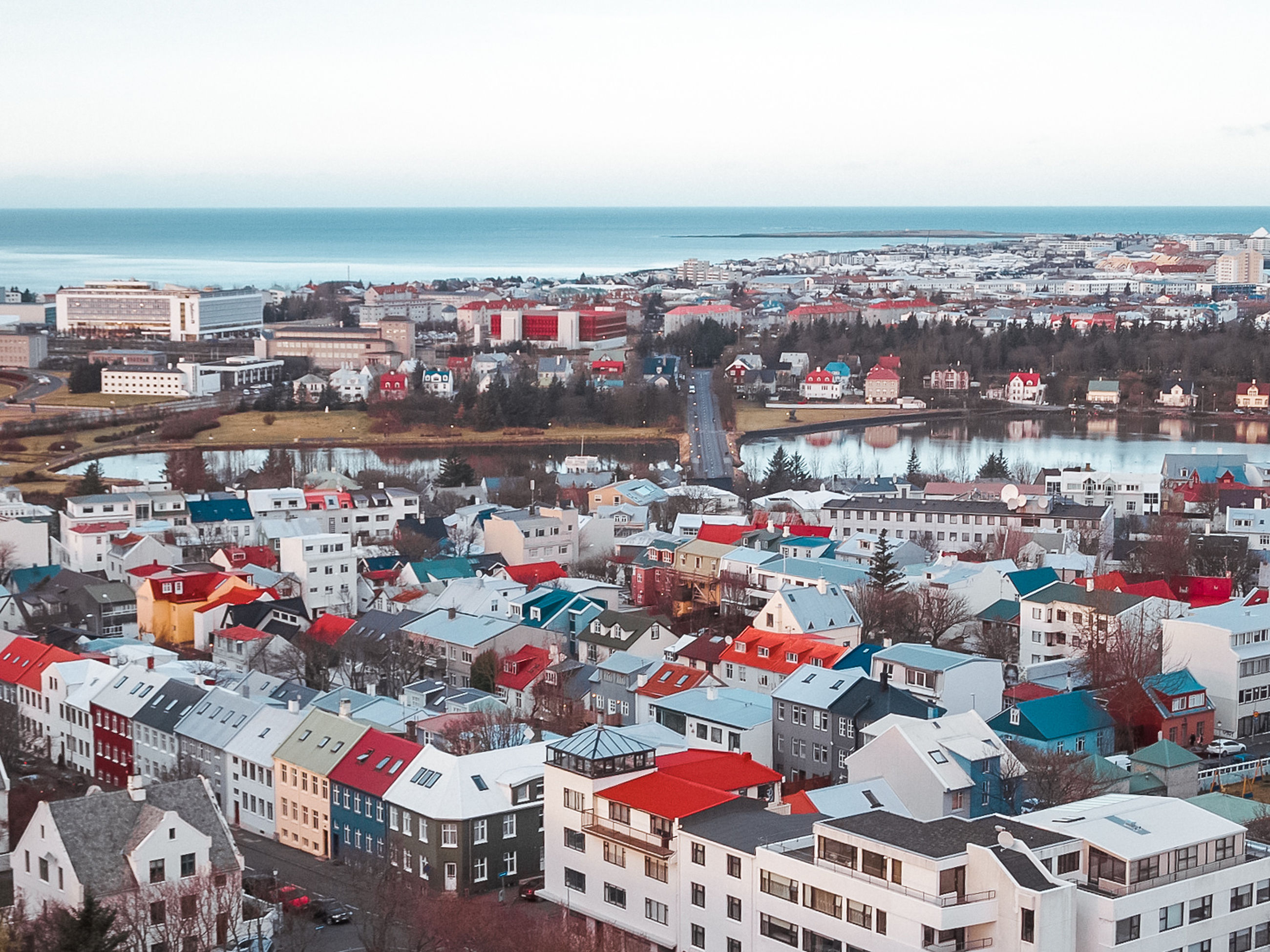 architecture, building exterior, built structure, sky, sea, city, water, horizon, horizon over water, cityscape, building, high angle view, crowd, day, residential district, crowded, nature, outdoors, community, townscape, settlement